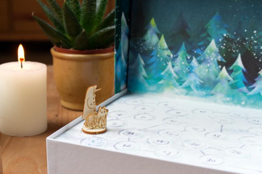Schnauzberts Winterreise Spielfigur: Hundekalender für den Dezember